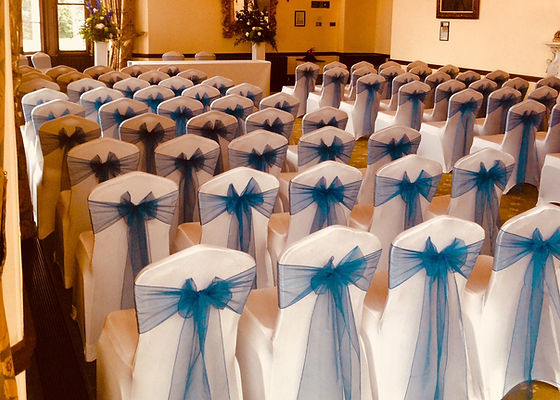 chair cover hire sussex zero gravity with side table the wedding suppliers covers ferrero pyramids arundel navy blue sashes demonstrating our first class sevice and attention to detail