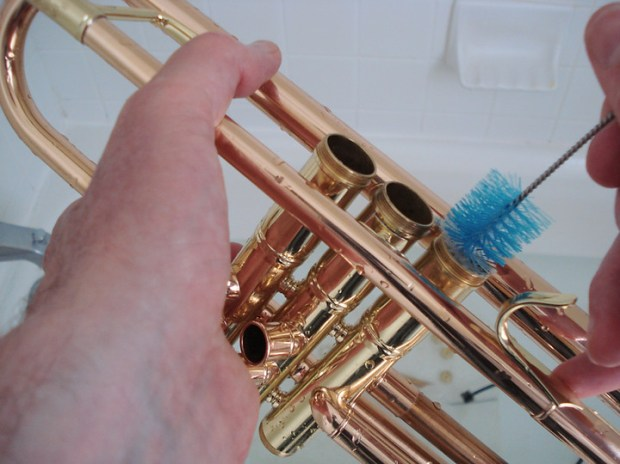 scrubbing a trumpet valve casing