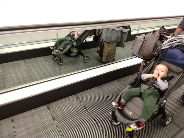 toddler on way to airport boarding