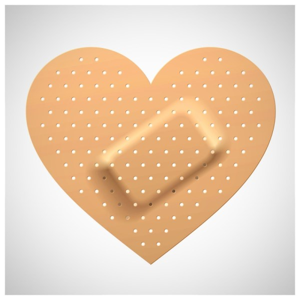 love causes broken hearts covered with heart shaped bandaids