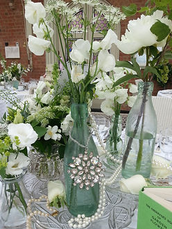 wedding chair covers melton mowbray artifort orange slice lola rose venue dressing hire sashes oakham stamford table center pieces with flowers and broaches