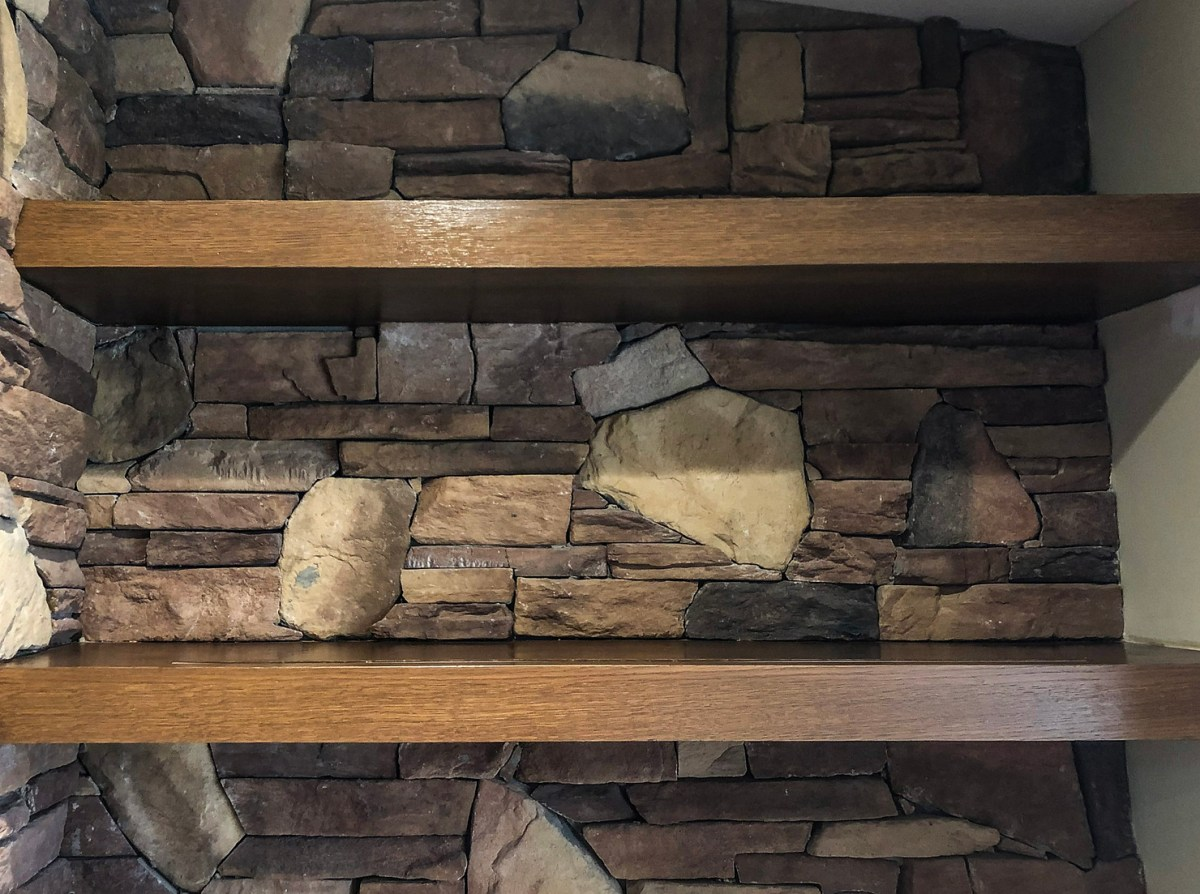 Living Room remodel uses stone on dry bar wall