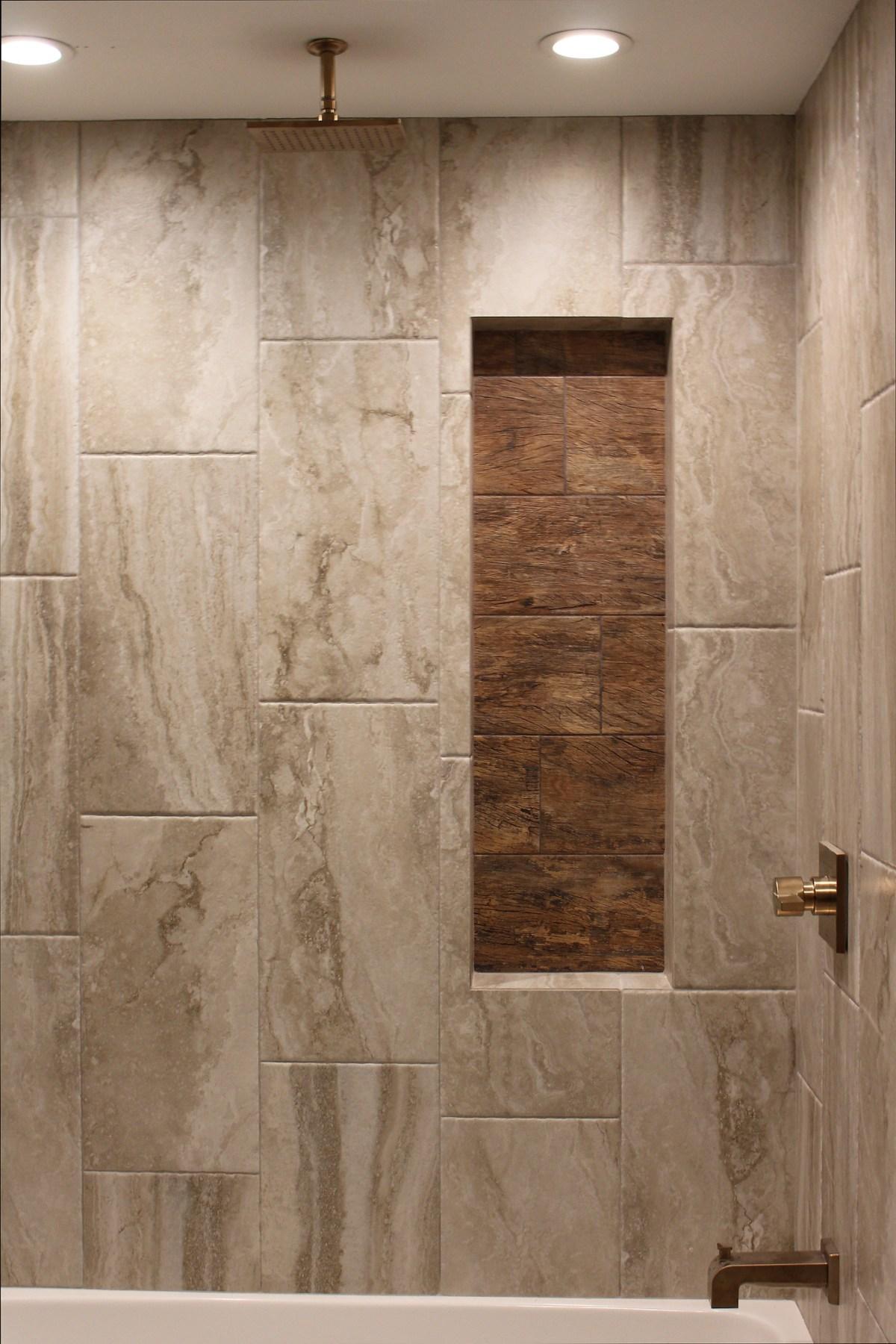 Bathroom remodel uses wood look tile in shower niche