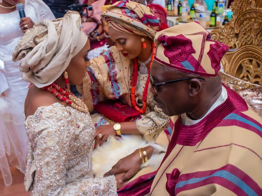 Mrs. Olutoye's mother, Modupe Fatunbi and her father, Dickson Fatunbi, pray over her during her traditional ceremony.