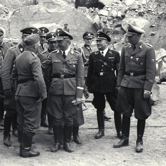 Himmler, the SS leader, fourth from right, visiting the Mauthausen concentration camp. Huber is sixth from right, at center rear.
