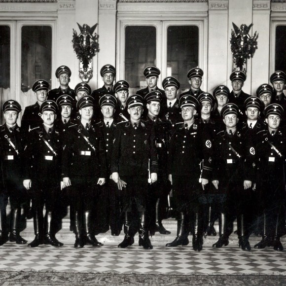 Franz Josef Huber, front row center, holding gloves, and his Vienna Gestapo team in an undated photograph.