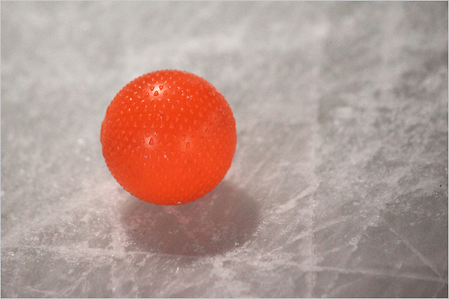 Bandy players cover more ice than they would in hockey and they pursue a ball not a puck