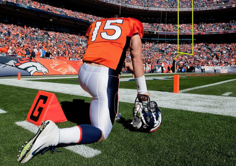 Image result for tim tebow praying before games