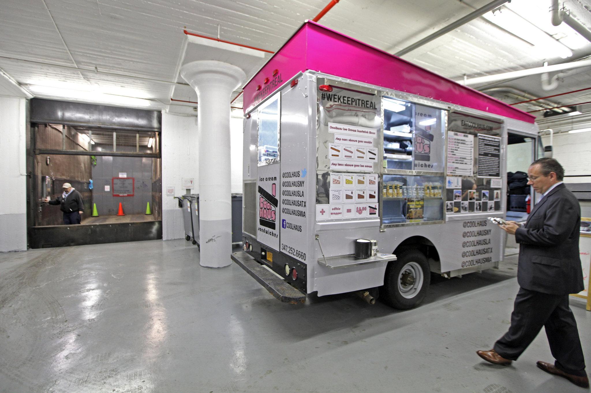 Food Trucks Serve a Chelsea Buildings Upper Floors  The