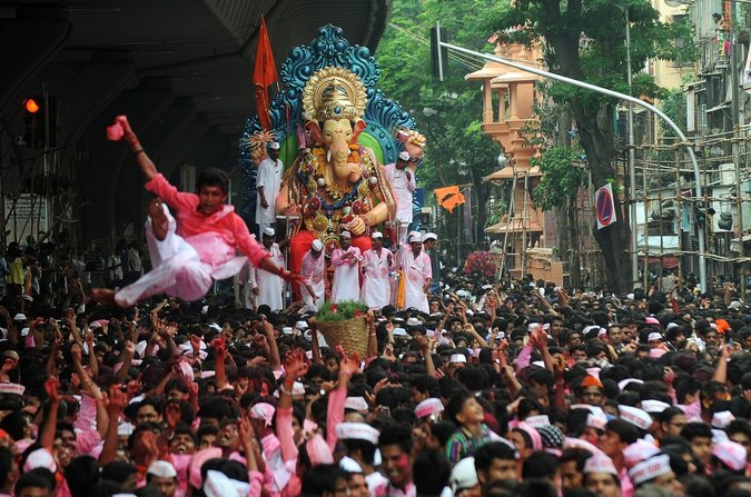 india mumbai nytimes ganesh festival crowds street colors