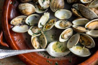 Melissa Clark makes steamed clams with fresh tarragon and minced chives.