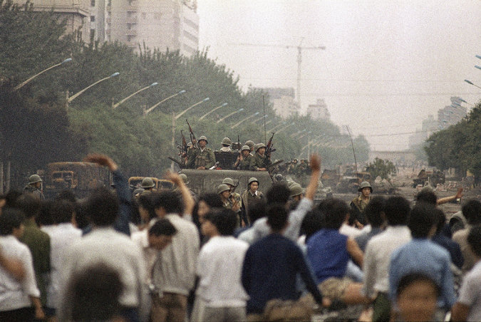 Residents and soldiers on the street in Beijing on June 6, 1989 after the crackdown on protesters. Credit LIU Heung Shing/Associated Press
