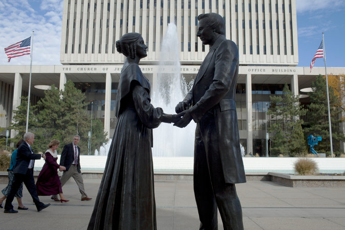 A statue of Joseph Smith and his first wife, Emma, at Temple Square in Salt Lake City. Photo credit Jim McAuley for The New York Times