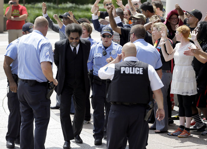 The scholar and author Cornel West was arrested on Monday by the St. Louis Police during a protest outside the Thomas F. Eagleton Federal Courthouse. Credit Jeff Roberson/Associated Press