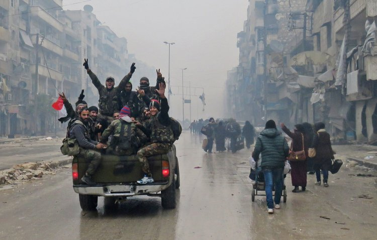 Government fighters celebrated as they seized eastern Aleppo. The United Nations has accused pro-government forces of killing women and children as they took the city.CreditAgence France-Presse — Getty Images