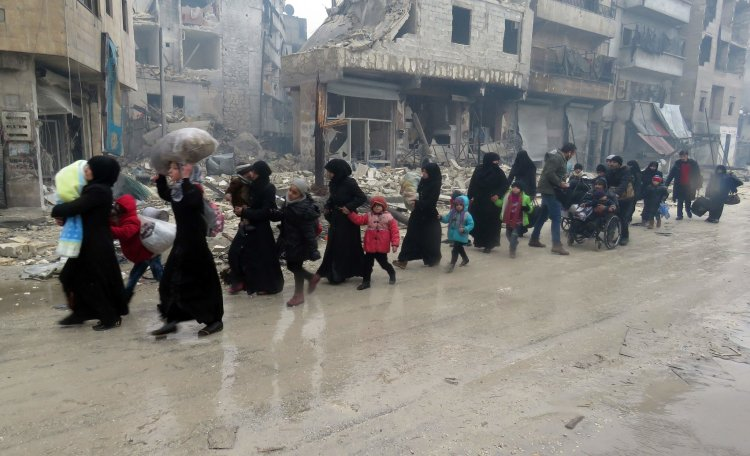 Residents who had fled the violence in the Bustan al-Qasr neighborhood reached Aleppo's Fardos area on Tuesday. CreditAgence France-Presse — Getty Images