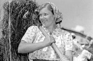 A woman working at a collective farm near Moscow in 1955.