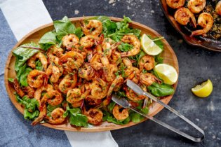In a recipe from the Minimalist archives, Mark Bittman tosses seared shrimp with arugula and mint to make an elegant salad that's not fussy.
