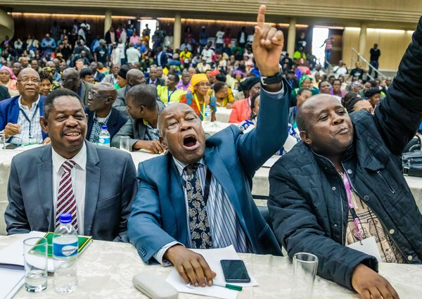 Christopher Mutsvangwa, center, head of the war veterans association, celebrated the dismissal of the president of the ruling ZANU-PF party on Sunday in Harare.