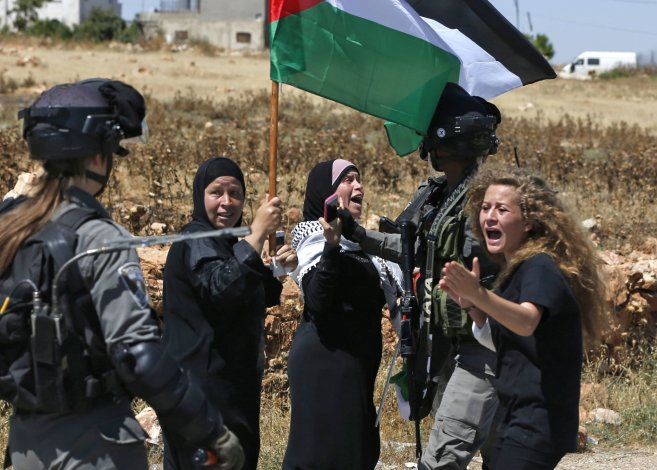 Ahed Tamimi, Palestinian Teen, Gets 8 Months in Prison for Slapping Israeli  Soldier - The New York Times