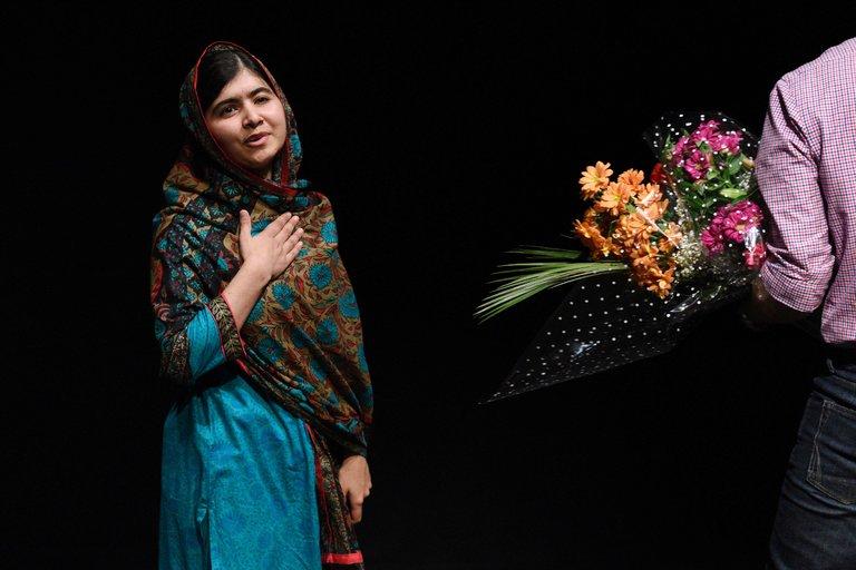 Malala offered flowers in Birmingham
