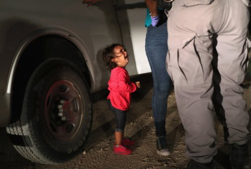 A Honduran toddler cries as her mother is searched and detained near the United States border with Mexico on June 12.