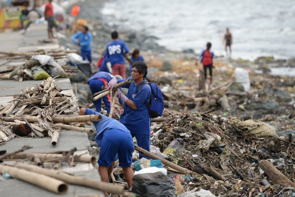 Rescue Workers Search For Missing After Typhoon Strikes