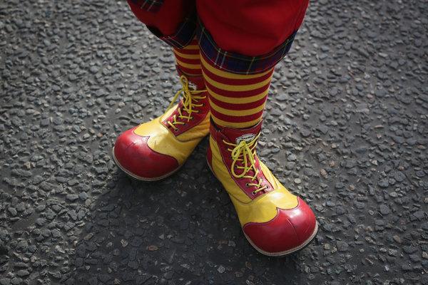 clown giving kids candy