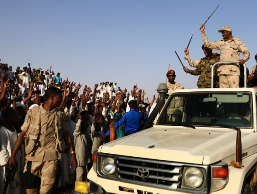 Lt. Gen. Mohamed Hamdan, top right, the deputy head of the military council that assumed power in Sudan after the overthrow of Mr. al-Bashir, seemed to be laying the groundwork for a political campaign during a rally in Garawee, Sudan, on Saturday.