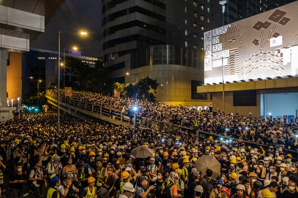 Security: Protesters gathered near Hong Kong's police headquarters on Friday night.