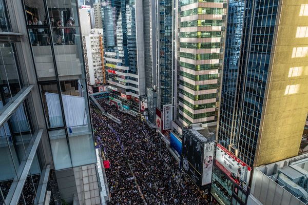 As a small group of protesters bashed their way into the city's legislature, hundreds of thousands of others marched peacefully in a separate demonstration on Monday.