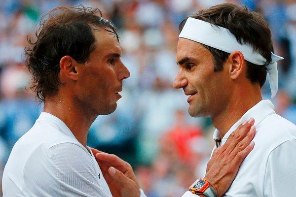 Nadal, left, and Federer after the match.
