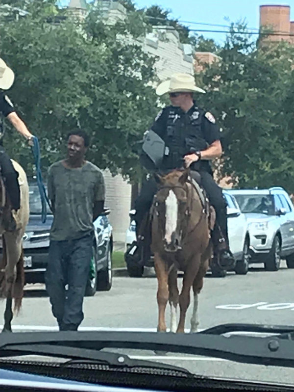 Image result for texas cops lead arrested man on a rope