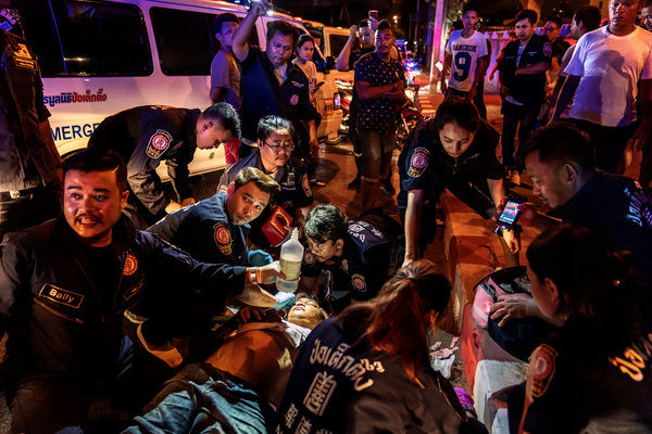 Paramedics treat an injured man after a motorcycle accident in Bangkok in April.