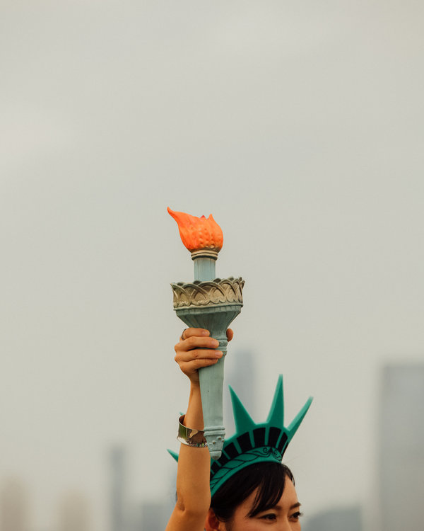 """A visitor to the Statue of Liberty in New York City. """"Give me your tired and your poor who can stand on their own two feet and who will not become a public charge,'"""" said Kenneth T. Cuccinelli, the director of United States Citizenship and Immigration Services, on Tuesday."""