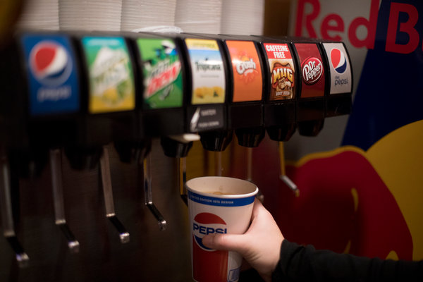 Taxes on sugary beverages and junk food would help lower health care costs.