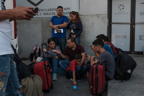After weeks of waiting for their turn, migrants in Nuevo Laredo, Mexico, prepared to cross into the United States to apply for asylum.