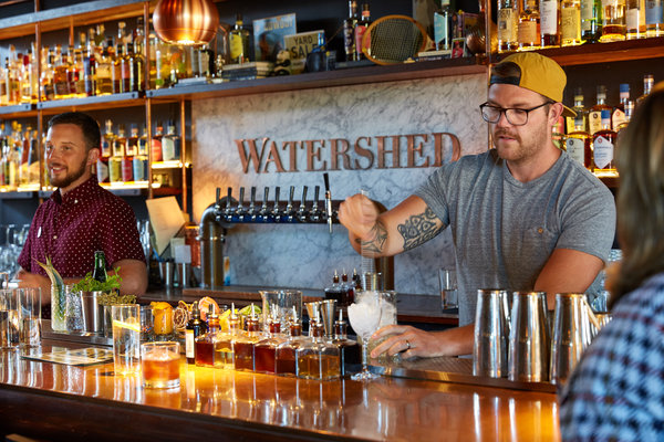 A bartender makes a cocktail at Watershed Kitchen & Bar, a full-service restaurant attached to Watershed Distillery in Columbus.