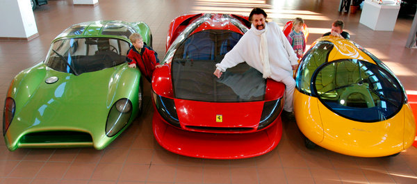 Mr. Colani in 2006 with some of his prototype cars. His work often used curves and bulges that were unapologetically erotic.