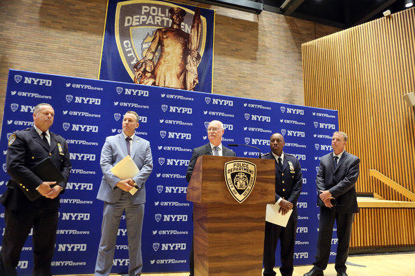 Brian O'Neill, center, an assistant chief of internal affairs for the New York Police Department, discussed the case against Officer Bailey on Thursday.