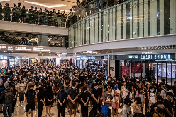 As night fell, hundreds of protesters decamped to a shopping mall near the Yuen Long subway station for a sit-in.