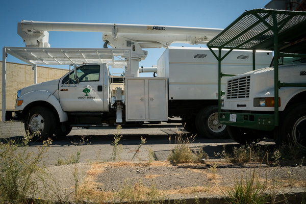 A Napa County parking lot serves as a staging area for trucks operated by Pacific Gas & Electric contractors.Insurance brokers said some contractors were seeing policies canceled or were unable to secure new coverage.