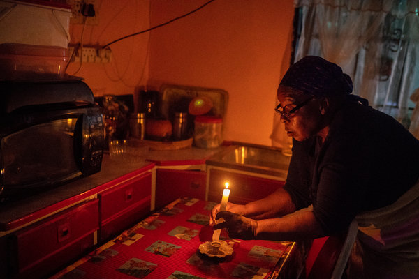 "Agnes Sehole uses candles for light. ""It's getting worse,"" said Ms. Sehole. ""There's nothing that I've experienced of the new South Africa."""