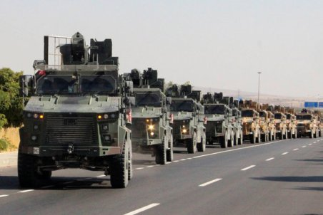 A Turkish military convoy near the Turkish-Syrian border on Wednesday.