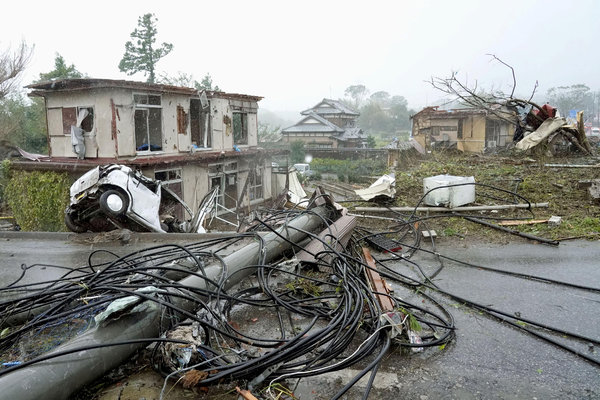 Fallen power lines and damaged houses and vehicles in Ichihara, east of Tokyo, on Saturday.