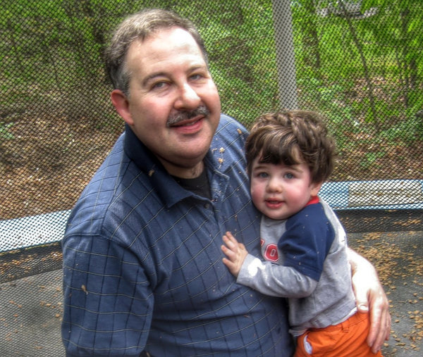 An undated photo of Leonard Pozner and his son, Noah.