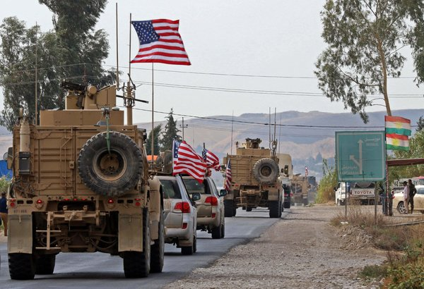United States military vehicles near Bardarash, Iraq, on Monday after withdrawing from northern Syria.