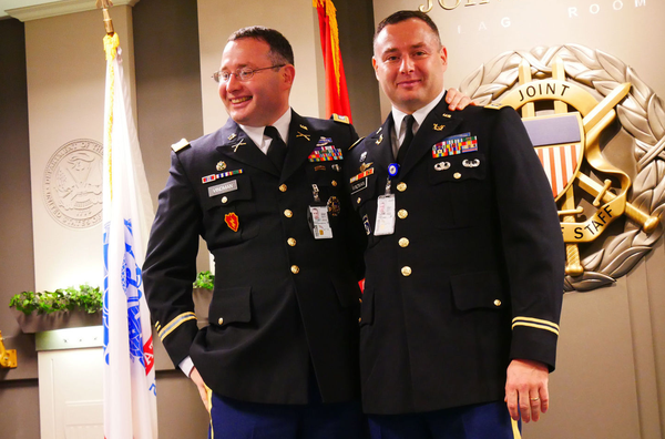 Alexander S. Vindman, left, with his twin brother, Yevgeny, at the Pentagon in 2016. They are both lieutenant colonels in the Army.