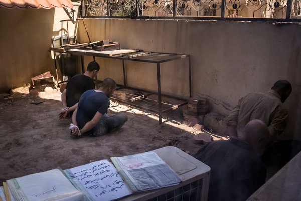 Suspected Islamic State fighters detained at a courthouse in Qaraqosh, Iraq, in 2017.