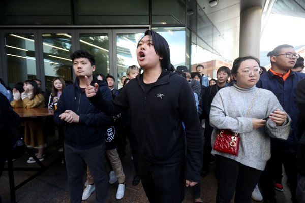 Pro-China students shouting at pro-Hong Kong protesters outside the University of South Australia in Adelaide in August.